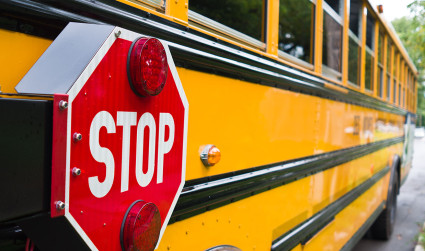 Wait, when should I stop for a school bus?