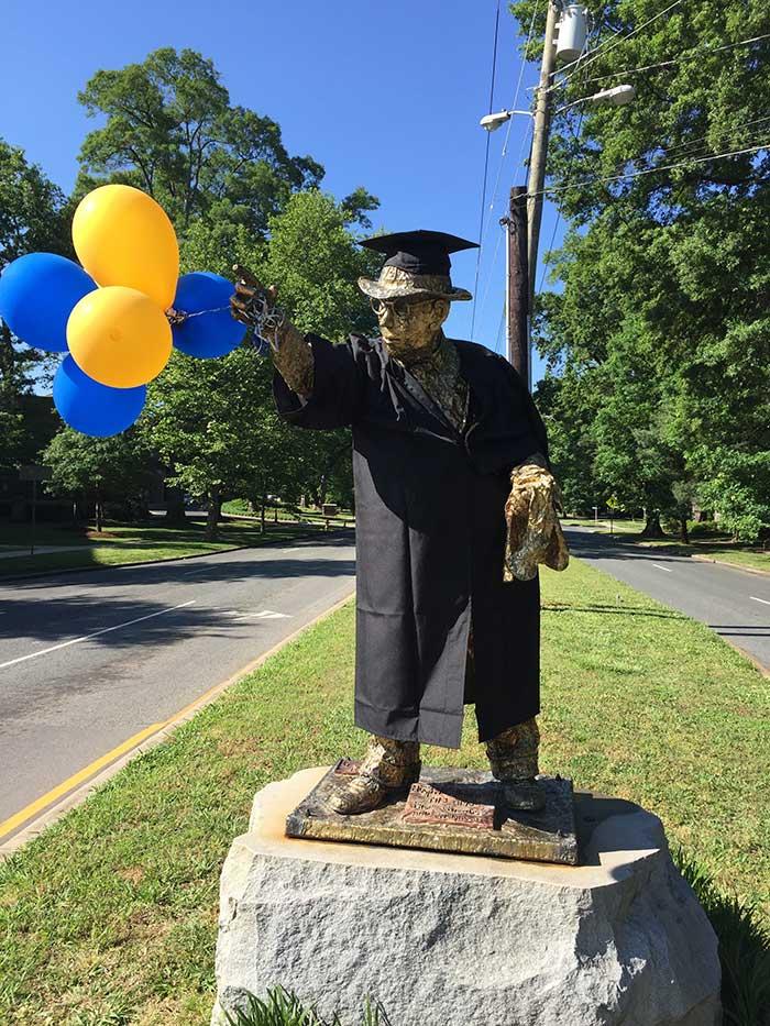 hugh-mcmanaway-gold-man-statue