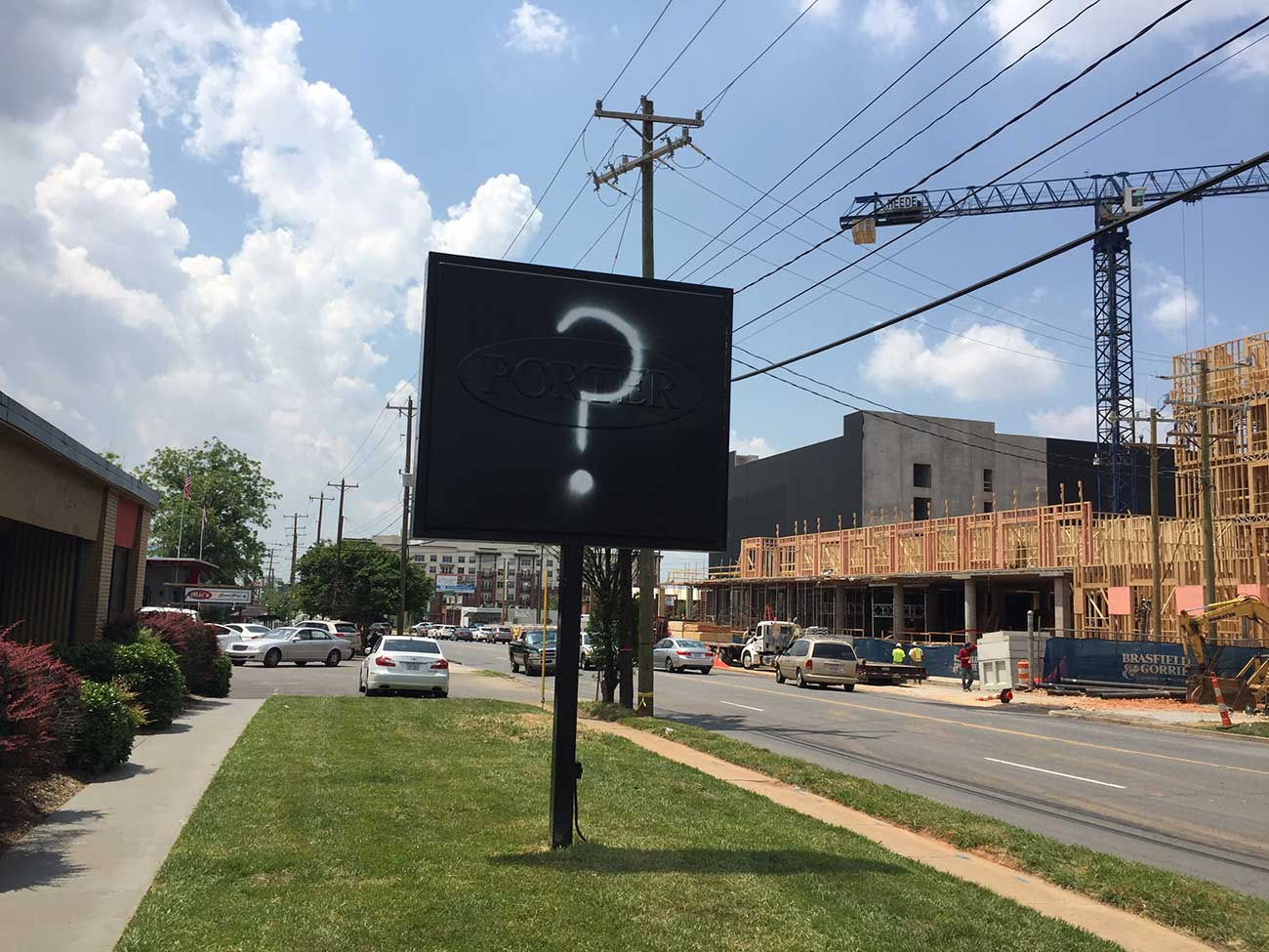 The Mac's people are behind that question mark sign on South Boulevard