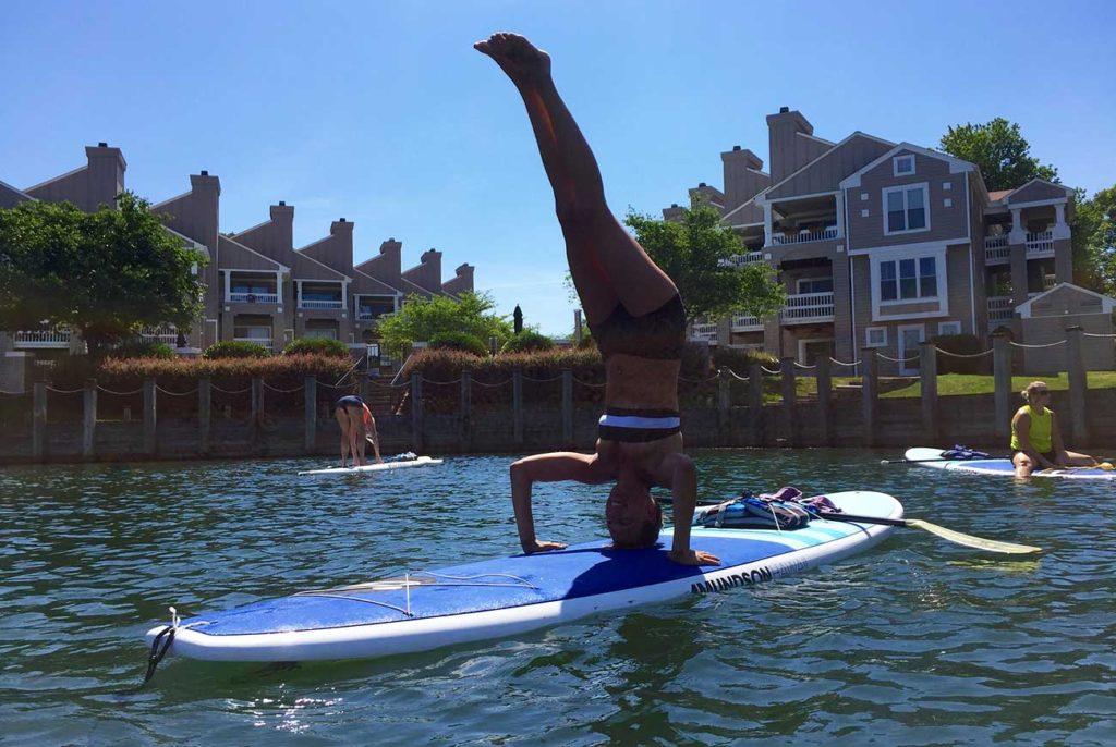Paddleboard yoga: Fad or workout?