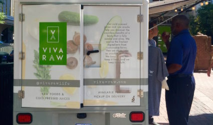What is a Tuk-tuk and why is Viva Raw selling juice Uptown out of one?