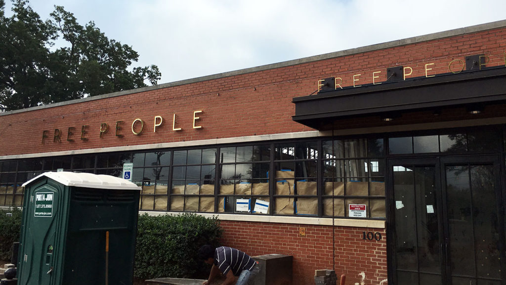 Free People signage goes up in South End. Will open soon.