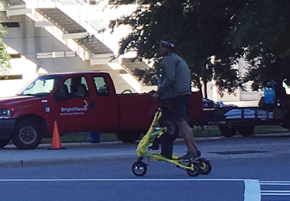 cam-newton-on-scooter-charlotte
