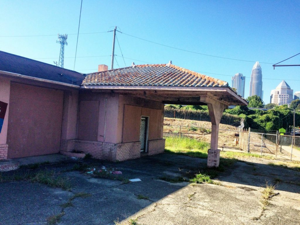 Can a dilapidated gas station carry historic significance for the city of Charlotte?