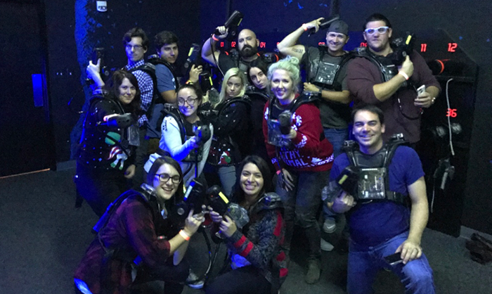 Because who doesn't have laser tag,tacky sweater-themed Christmas parties?