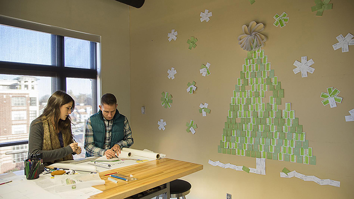 Their employees had to use old business cards and recycled materials to create their decorations. Love it.