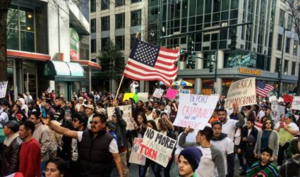 Thousands marched in Uptown yesterday for Charlotte's 'Day Without Immigrants'