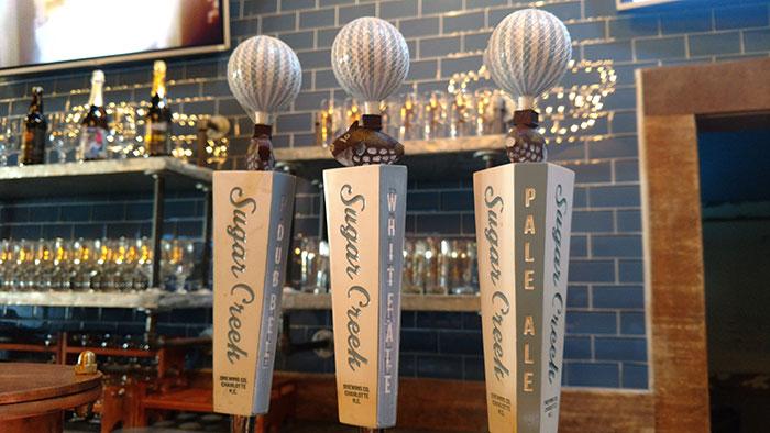 Sugar-Creek-Brewing-Company-taps
