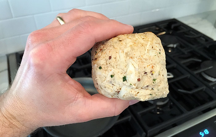 raw-crab-cake-holding