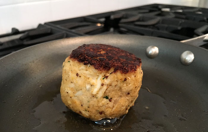 searing-crab-cake-from-clean-catch-charlotte