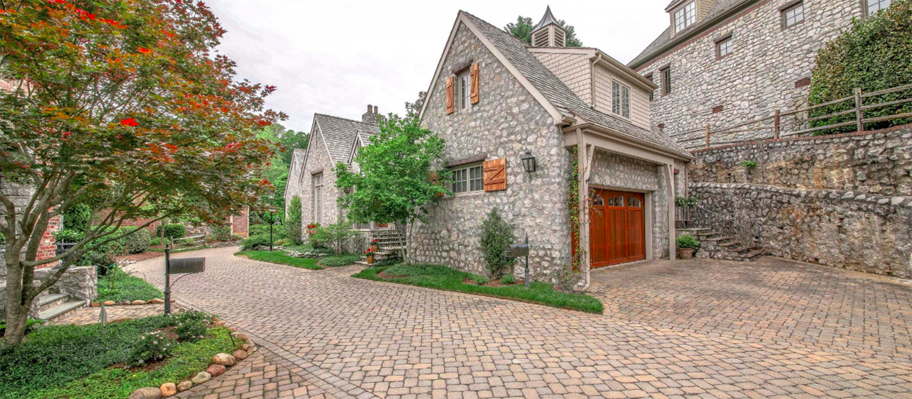 """Tiny subdivision of 17 homes creates """"French Village"""" with cobblestone streets and listings from $700K to $1.5M"""