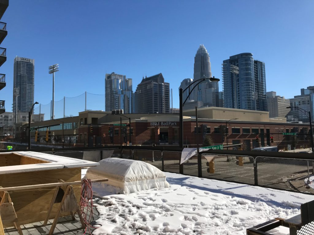 A look at construction progress and the menu at Graham St. Pub, Uptown's newest rooftop bar