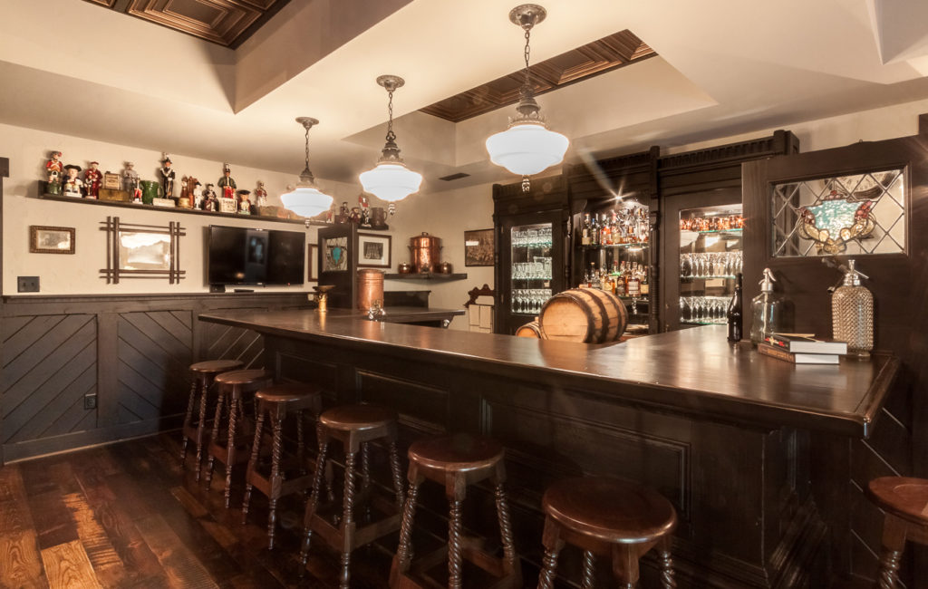 You've got to see this Ri Ra-inspired Irish pub basement in an English Tudor home asking $2.2 million