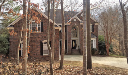 All brick waterfront home with a private stone path leading to...