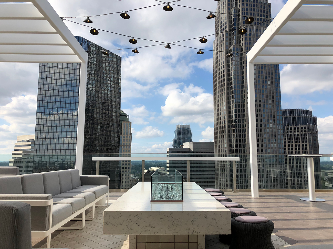 Nuvolé, a swanky rooftop bar and lounge, is now open on the 22nd floor of the new AC Hotel