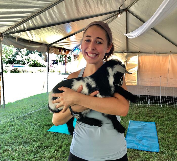 holding goat for yoga charlotte