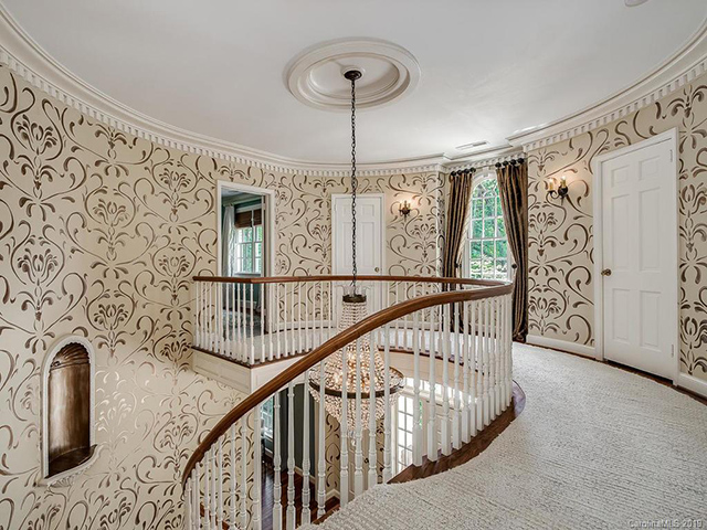 737 Queens Road W spiral stairs