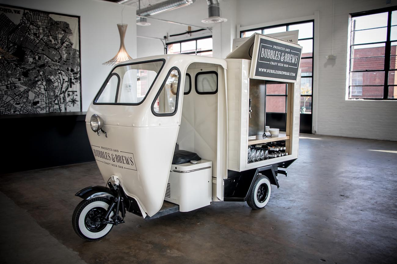 You can rent a vintage, full-service mobile bar with 7 taps and customizable display for $900+