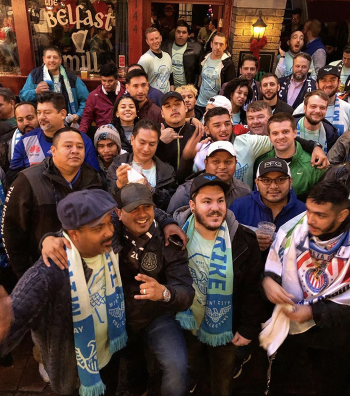 MLS fans celebrate in Brevard Court hours after Charlotte was awarded the league's 30th expansion team
