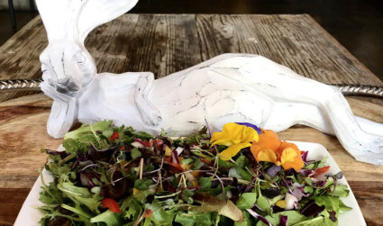Deluxe opens in former Loft & Cellar space — plates include dishes with such art as a wooden carved rabbit