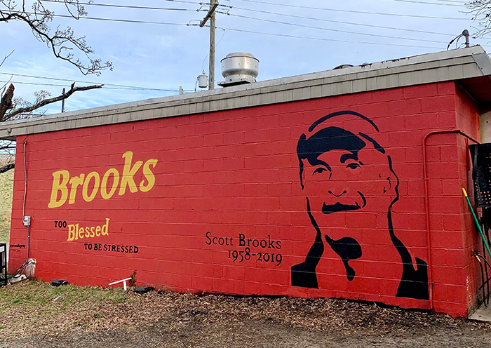 A mural of Scott Brooks was painted onto his family's business, Brooks' Sandwich House, after his murder in December.