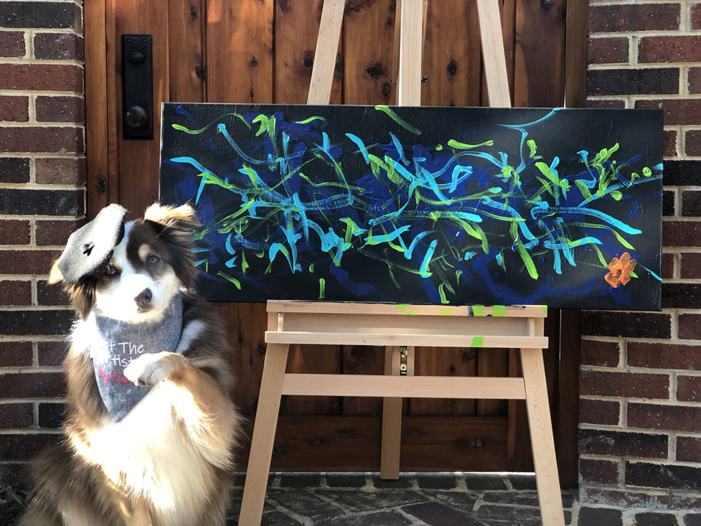 This painting dog's artwork sales yielded 2,000 pounds of food donations to Second Harvest