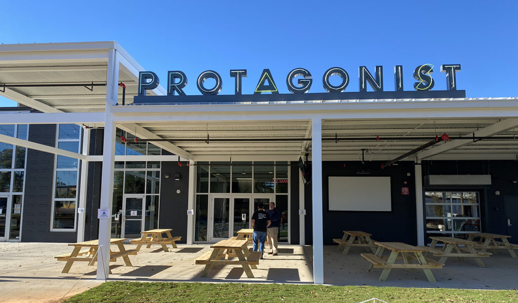 Protagonist Beer's second location is now open with pizza slices bigger than your head