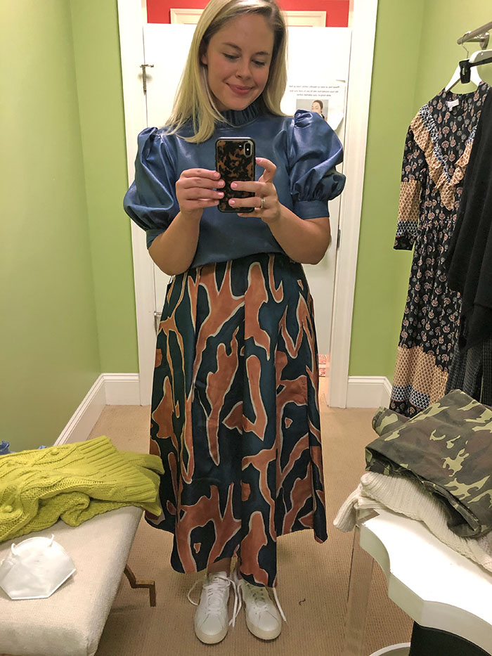 Charlotte's leather top paired with colorful skirt