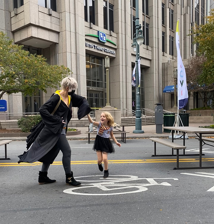 Allie Kelly and daughter dancing in Uptown after learning about Biden's victory